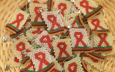World AIDS Day badges from Tiyesa ('Let's Try') women's group