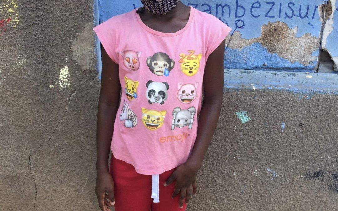 Tiyese face masks at Nekacheya School.